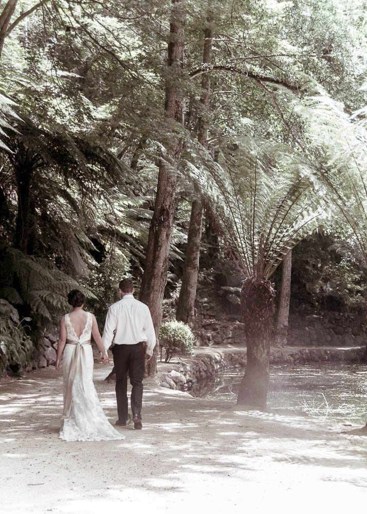 Bride and groom walking in the gardens