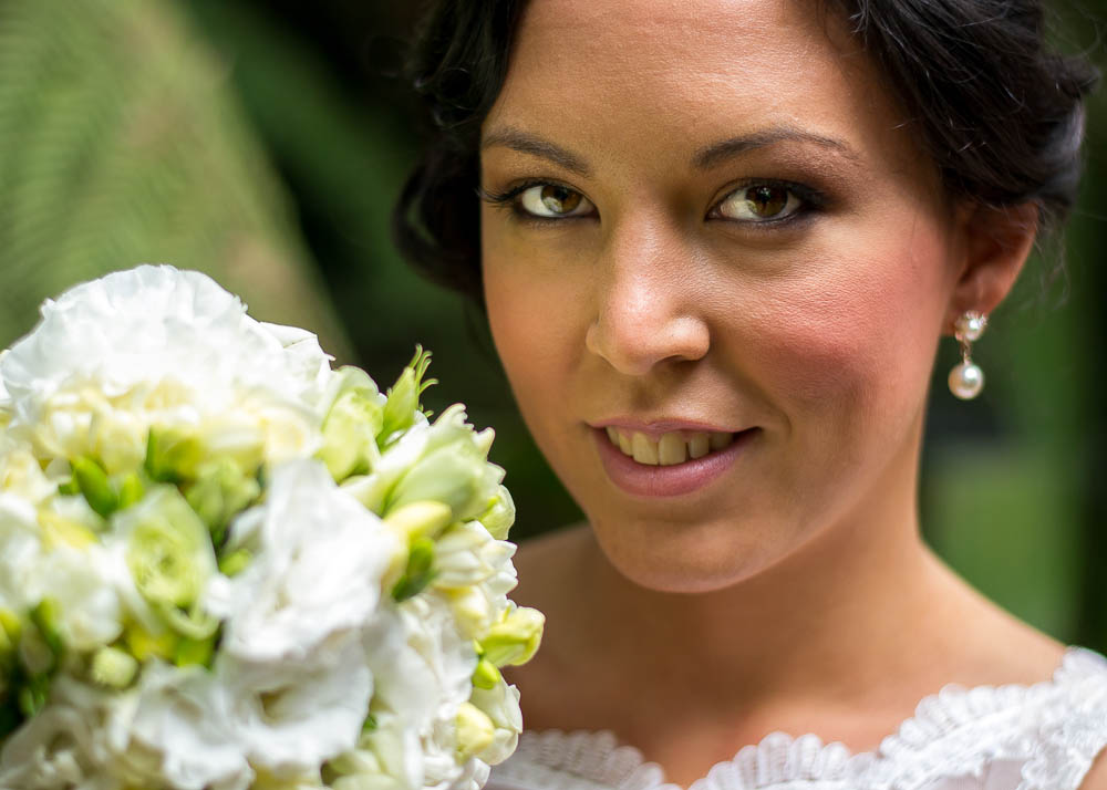 Bride with flowers reflecting in eyes