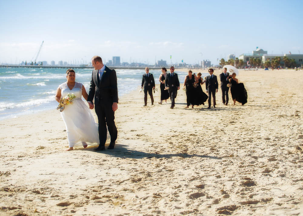 Strolling on St Kilda beach after the wedding