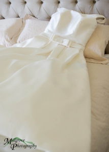 Wedding dress lying on the bed