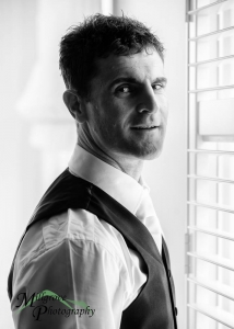 Groom in black and white, preparing for his wedding