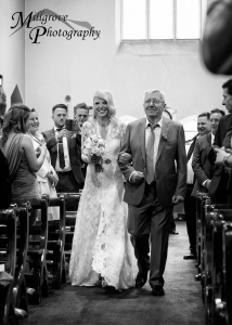Bride and father walking down the aisle