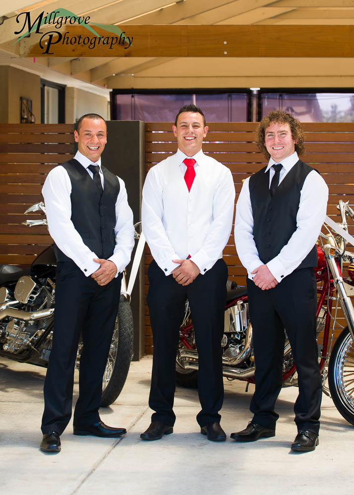 Groom David with his groomsmen and Harley Davidsons in background