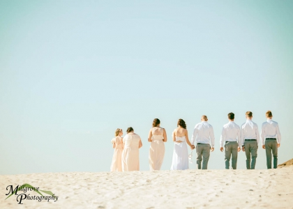 Bridal party walking along the beach in Melbourne