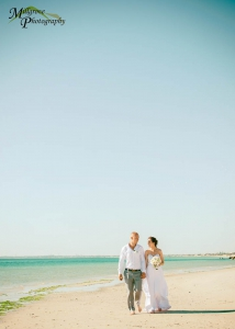Bride Rachel and Groom Phill walking on the beach at Carrum, Melbourne