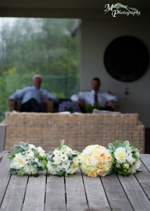 Wedding flowers with Dad and brother in the background