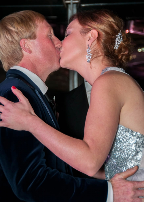 Bride and groom with their first kiss at Mon Bijou, Melbourne