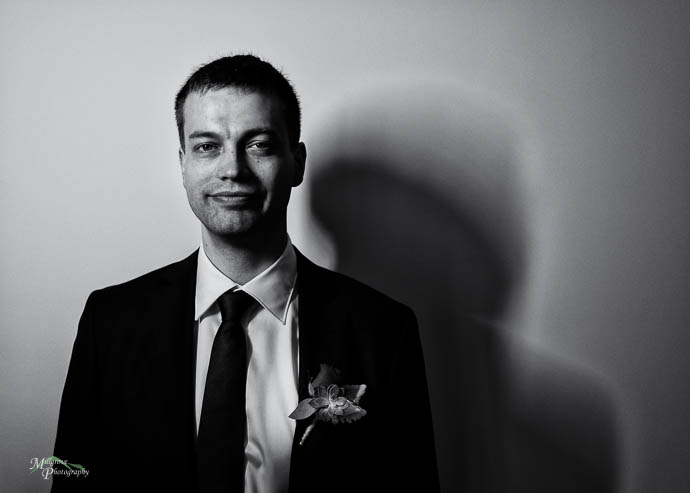 Black and white portrait of a groom
