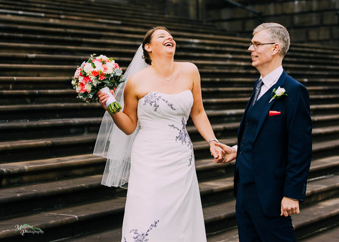 Bride and groom on the steps of Parliament House, Melbourne