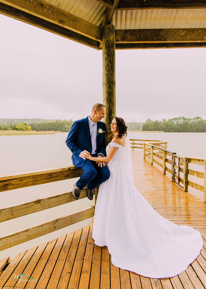 Wedding photos of bride and groom in rotunda at Lilydale Lake