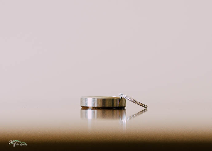 Wedding rings reflected on a table