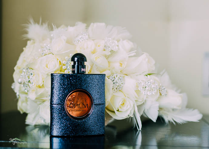 Perfume in front of bridal bouquet
