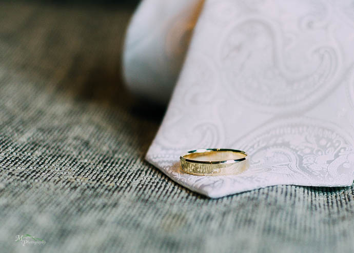 Wedding ring on a groom's white tie