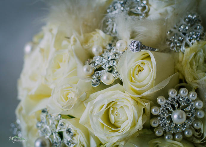 Engagement ring in the bride's bouquet