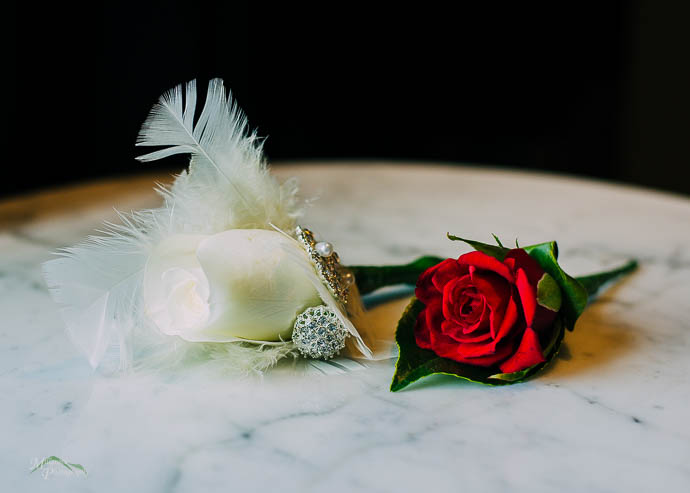 A white and red rose on a marbel table