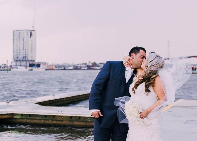 Bride and groom outside All Smiles Melbourne Waterfront on a co