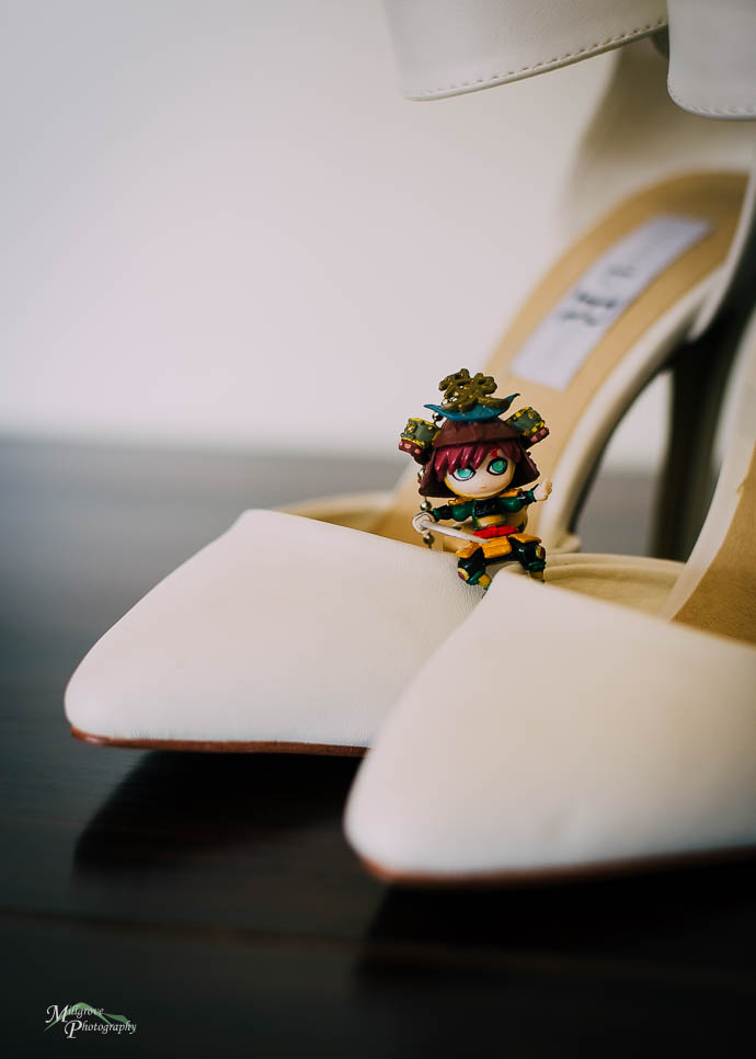 Little japanese anime figure on bride's shoes