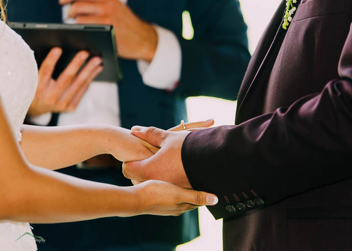 Exchanging rings in a wedding ceremony at Immerse Winery, Yarra
