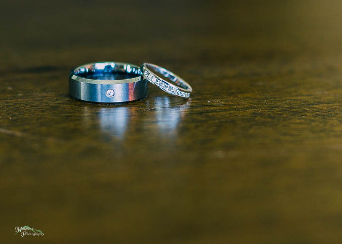 Wedding rings on a timber table