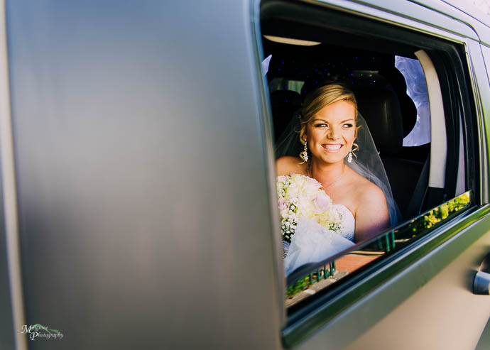 Bride Renee in the back of her limo