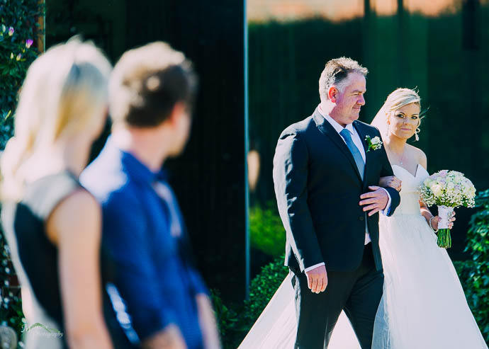 Bride and her Dad walking down the aisle at a Roselyn Court wedding