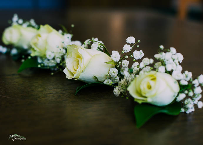 White roses for wedding buttonholes