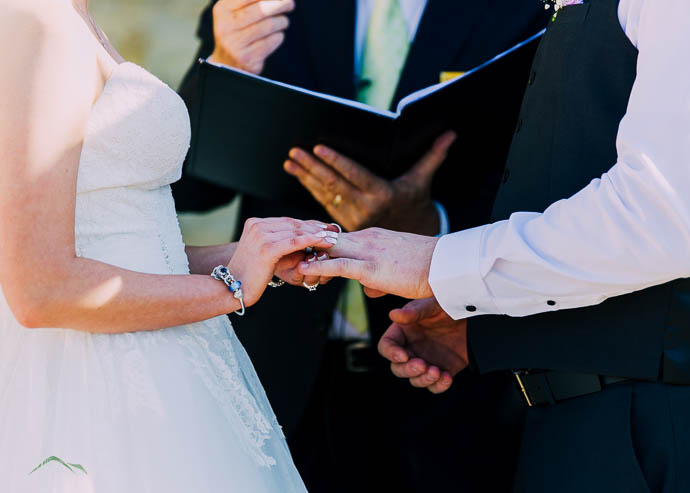 Broad placing remain on the groom's finger