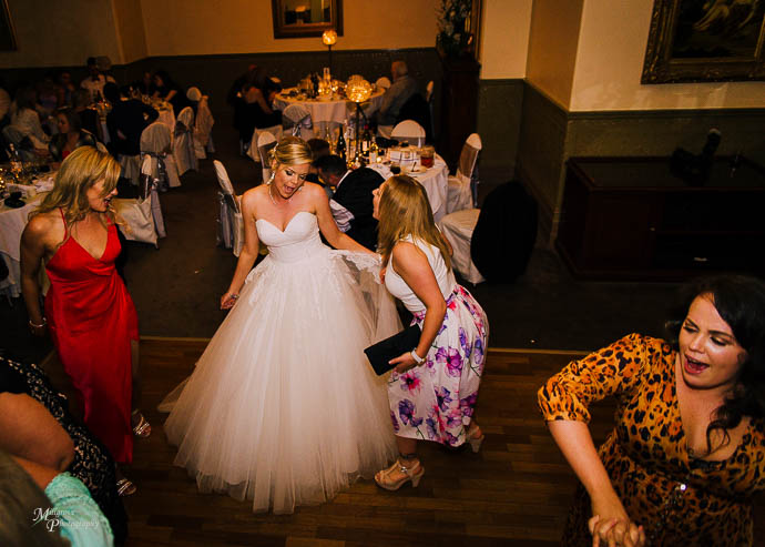 Bride dancing during the reception at Roselyn Court