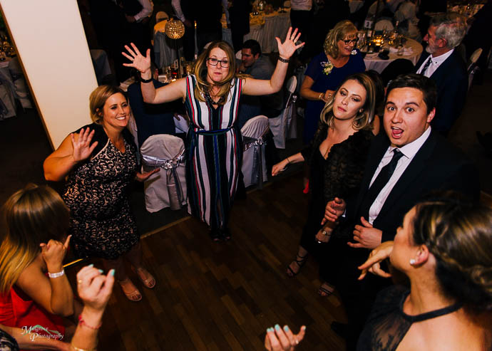 dancing during the reception at Roselyn Court