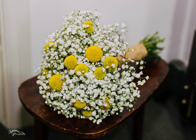 Wedding bridal bouquet on a timber stool