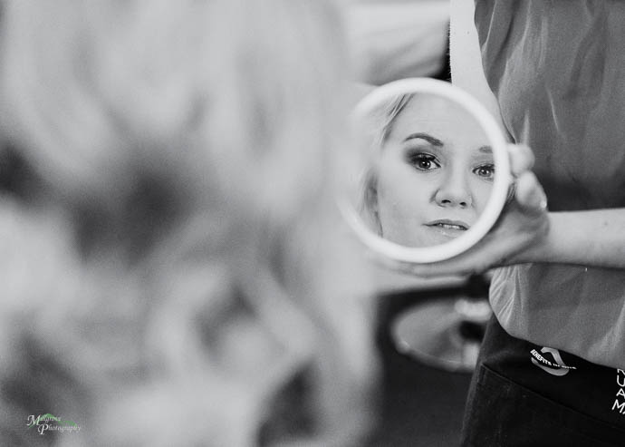 Bride reflected in a round mirror