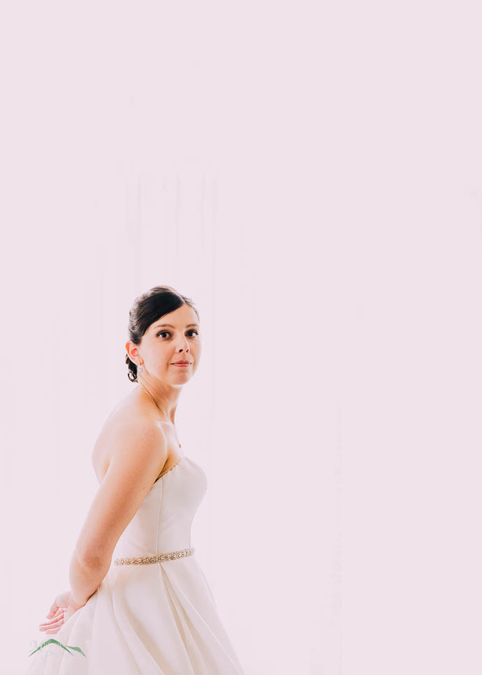 Bride getting ready in the bridal suite at Lake House, Daylesfor