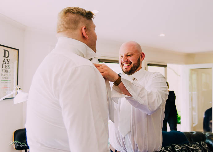 Groom and Groomsmen getting ready pre-wedding at Lake House, Day