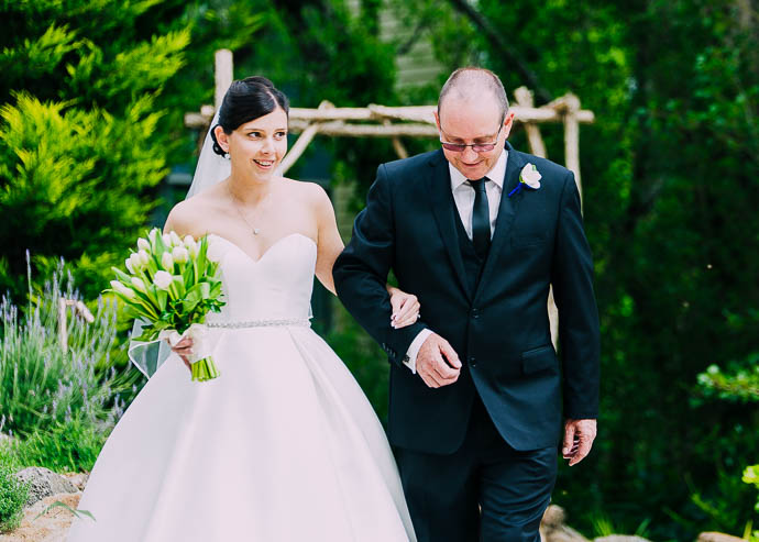 Bride walking down the aisle with her father at a Lake House, Da