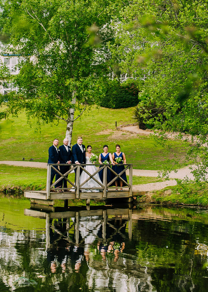 Bridal party by the lake at Lake House, Daylesford