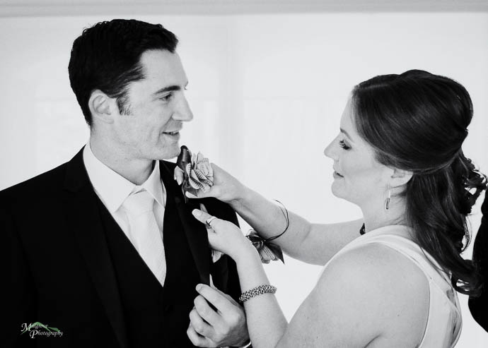 "Female ""Groomsman"" helping Groom with his tie"