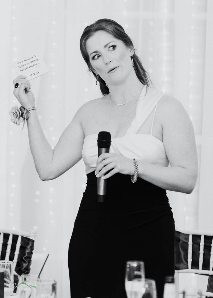 Person giving a speech at a wedding