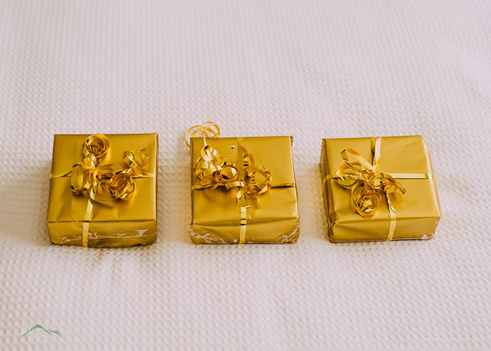 3 presents wrapped in gold