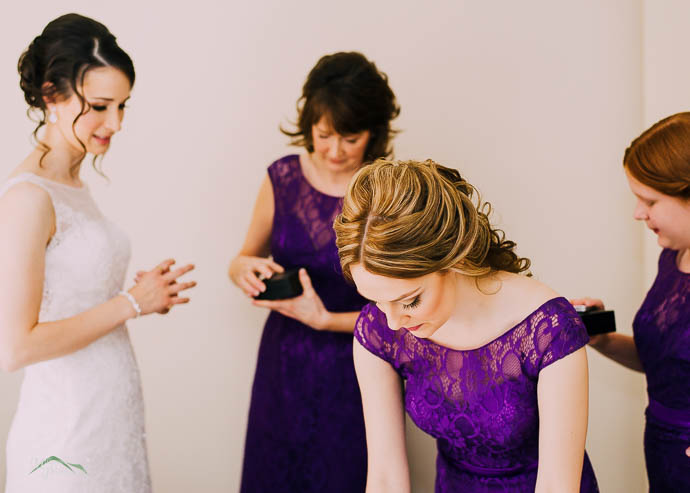 Bridesmaids helping Bride with jewellery