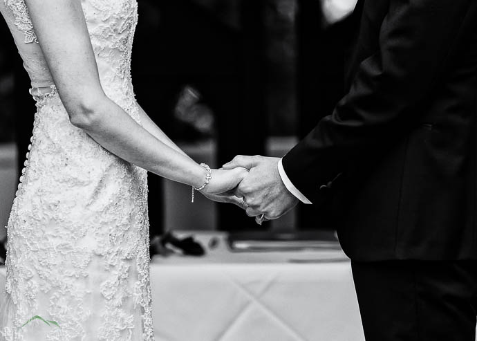 Bride and Groom holding hands during wedding