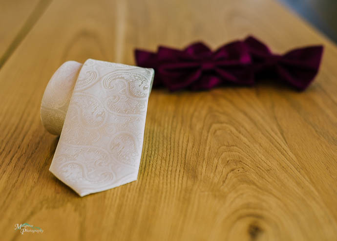 Wedding tie with 4 bow ties in background