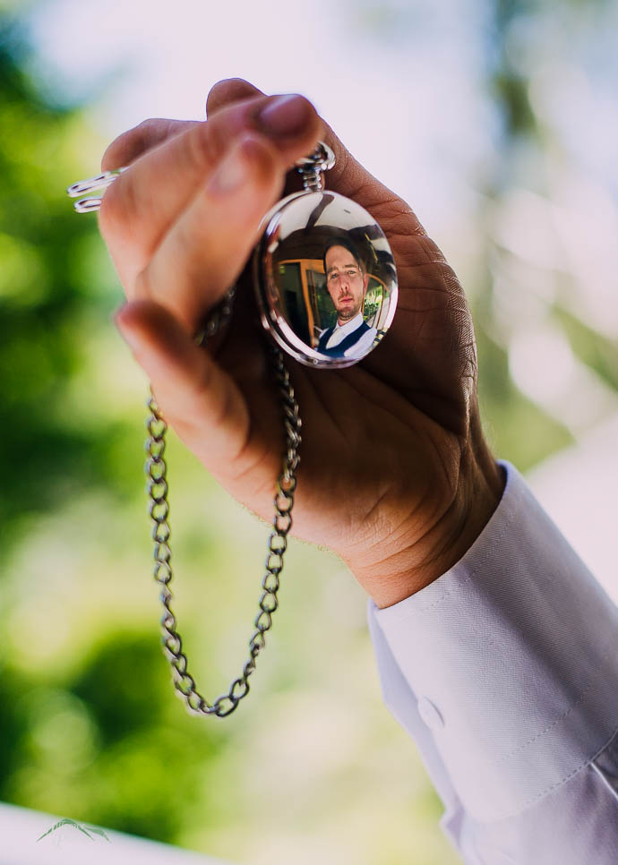 Groom's reflection in pocket watch