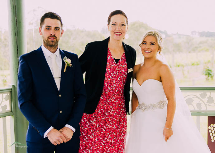 Celebrant in a photo with bride and groom
