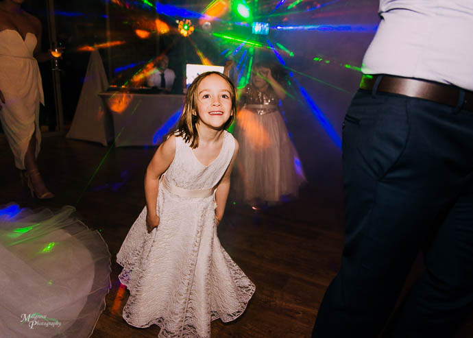 Candid moments of people dancing during the reception at Wild Cattle Creek Winery