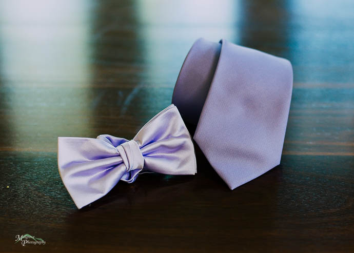 Purple ties on a wooden table