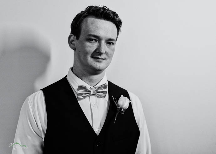 A portrait of a groom, black and white