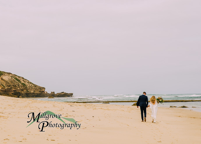 A bride and groom on the beach at Sorrento