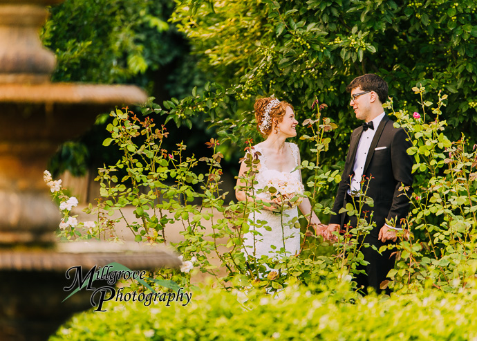A bride and groom in a garden