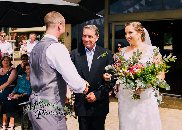 A bride and groom on the deck at Parnassus Vineyard