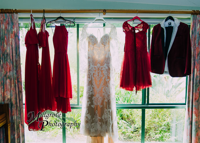 Dresses hanging in a window